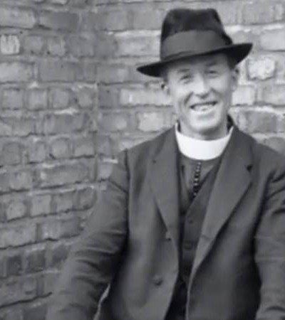 Father O'Flanagan smiling